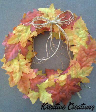 This no sew fabric wreath adds a touch of elegance to your front door during the holidays. - The Kreative Life