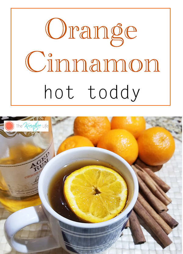 An orange cinnamon hot toddy made with rum is good for helping you get through the flu or a bad cold. - The Kreative Life